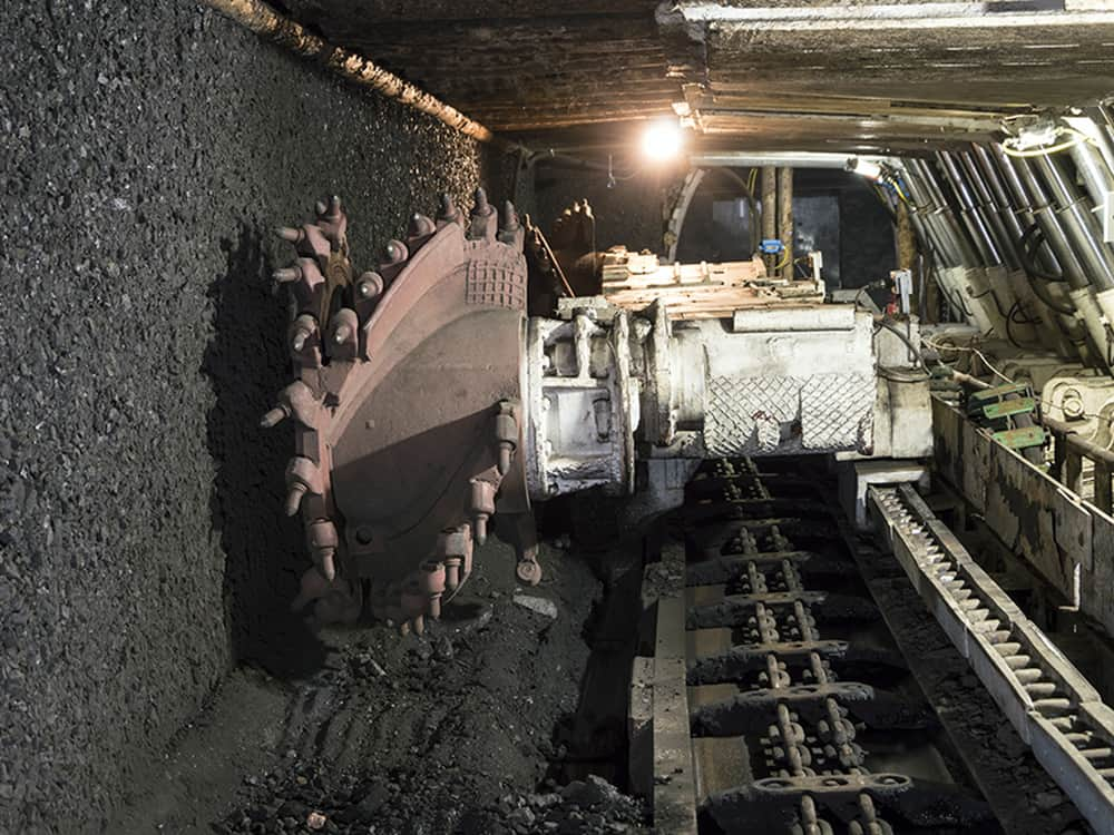 Mine excavator facing coal wall