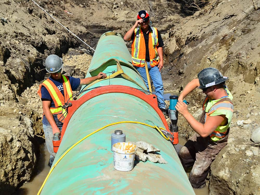 Workers working on a pipeline in Black Mountain - Victaulic