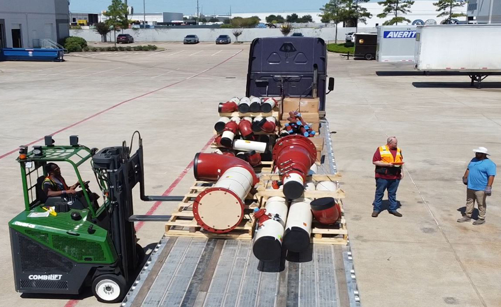 Loading the pipe spools on the bed of the truck